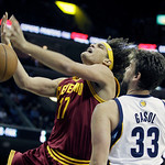 Cleveland Cavaliers' Anderson Varejao (17), of Brazil, tries to get an offensive rebound over Memphis Grizzlies' Marc Gasol (33), of Spain, during the first half of an NBA basketball game in …