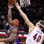 Phoenix Suns' Shannon Brown (26) jumps to the basket against Cleveland Cavaliers' Tyler Zeller (40) during the third quarter in an NBA basketball game Tuesday, Nov. 27, 2012, in Cleveland. T …