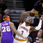 Phoenix Suns' Shannon Brown (26) knocks the ball loose from Cleveland Cavaliers' Dion Waiters (3) during the first quarter in an NBA basketball game Tuesday, Nov. 27, 2012, in Cleveland. The …