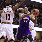 Phoenix Suns' P.J. Tucker (17) jumps to the basket between Cleveland Cavaliers' Tristan Thompson (13) and another defender during the second quarter of an NBA basketball game Tuesday, Nov. 2 …