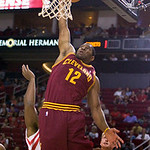 Cleveland Cavaliers forward Joey Graham (12) scores past Houston Rockets forward Chase Budinger (10) in the first half of an NBA preseason basketball game Sunday, Oct. 10, 2010, in Houston.  …