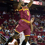 Cleveland Cavaliers forward Christian Eyenga (8) drives for a basket past Houston Rockets defenders Patrick Patterson (54) and Jordan Hill (27) in the second half of an NBA preseason basketb …