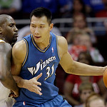 Washington Wizards forward Yi Jianlian, from China, tries to get past Cleveland Cavaliers forward Jawad Williams in the second quarter of an NBA preseason basketball game Thursday, Oct. 7, 2 …
