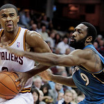 Washington Wizards point guard Gilbert Arenas, right, puts pressure on Cleveland Cavaliers point guard Ramon Sessions in the second quarter in an NBA preseason basketball game Thursday, Oct. …