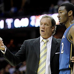 Washington Wizards head coach Flip Saunders, left, talks with John Wall in the fourth quarter in an NBA preseason basketball game against the Cleveland Cavaliers on Thursday, Oct. 7, 2010, i …