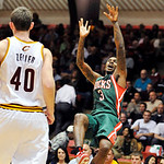Milwaukee Bucks guard Brandon Jennings (3) shoots off-balance over Cleveland Cavaliers forward Tyler Zeller (40) in the second quarter of a preseason NBA basketball game, Tuesday, Oct. 9, 20 …