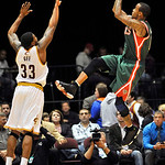 Milwaukee Bucks guard Monta Ellis, right, shoots over Cleveland Cavaliers guard Alonzo Gee during the first quarter of a preseason NBA basketball game, Tuesday, Oct. 9, 2012, in Canton, Ohio …