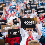 Jill Riegelmayer of Cleveland holds one of approximately 20,000 signs that where handed out to the crowd at Cleveland's Independence Day celebration on Thursday, July 1, 2010 as part of the  …