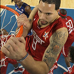 West All-Star Deron Williams of the Utah Jazz hangs on the rim after a first-half dunk during the NBA All-Star basketball game Sunday, Feb. 14, 2010, at Cowboys Stadium in Arlington, Texas.  …