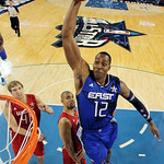 East All-Star Dwight Howard (12) of the Orlando Magic sails in for a dunk in the second half of the NBA All-Star basketball game Sunday, Feb. 14, 2010, at Cowboys Stadium in Arlington, Texas …
