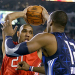 West All-Star Tim Duncan of the San Antonio Spurs goes up against East All-Star Dwight Howard (12) of the Orlando Magic in the third quarter of the NBA All-Star basketball game Sunday, Feb.  …