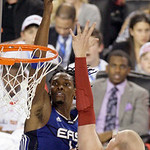 East All-Star Chris Bosh, left, of the Toronto Raptors goes up for a basket against West All-Star Chris Kaman of the Los Angeles Clippers during the second quarter of the NBA All-Star basket …