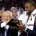 East All-Star Dwyane Wade, right, of the Miami Heat receives the MVP trophy from NBA commissioner David Stern after the East beat the West 141-139 in the NBA All-Star basketball game Sunday, …