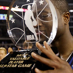 East All-Star Dwyane Wade of the Miami Heat jokes around as he holds up the MVP trophy after the East beat the West 141-139 in the NBA All-Star basketball game Sunday, Feb. 14, 2010, at Cowb …