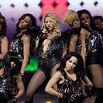 Shakira, center, performs during the halftime of the NBA All-Star basketball game Sunday, Feb. 14, 2010, at Cowboys Stadium in Arlington, Texas. (AP Photo/LM Otero)