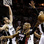 Miami Heat's Ray Allen (34) loses the ball as San Antonio Spurs' Manu Ginobili (20), of Argentina, Tim Duncan (21), and Danny Green (4) defend during the second half at Game 5 of the NBA Fin …