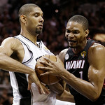 Miami Heat's Chris Bosh (1) is defended by San Antonio Spurs' Tim Duncan (21) during the second half at Game 5 of the NBA Finals basketball series, Sunday, June 16, 2013, in San Antonio. (AP …