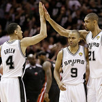 San Antonio Spurs' Danny Green (4), Tony Parker (9) and Tim Duncan (21) react against the Miami Heat during the second half at Game 5 of the NBA Finals basketball series, Sunday, June 16, 20 …