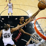 Miami Heat's Chris Bosh (1) shoots as San Antonio Spurs' Tim Duncan (21) defends during the first half at Game 5 of the NBA Finals basketball series, Sunday, June 16, 2013, in San Antonio. ( …