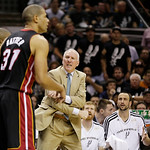 San Antonio Spurs' Gregg Popovich and the bench react as the Miami Heat's Shane Battier (31) passes during the first half at Game 5 of the NBA Finals basketball series, Sunday, June 16, 2013 …