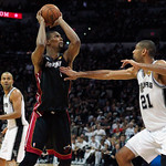 Miami Heat forward Chris Bosh, center, goes to the basket against San Antonio guard Tony Parker, left, of France, and forward Tim Duncan during the second quarter of Game 5 in the NBA Finals …