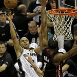 San Antonio Spurs' Tony Parker (9) shoots against Miami Heat's Chris Bosh (1) during the second half at Game 5 of the NBA Finals basketball series, Sunday, June 16, 2013, in San Antonio. The …