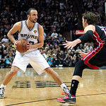 San Antonio guard Manu Ginobili, left, of Argentina, looks to pass against Miami Heat forward Mike Miller during the fourth quarter of Game 5 in the NBA Finals in San Antonio on Sunday, June …