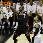 Miami Heat's Dwyane Wade (3) gets around San Antonio Spurs' Danny Green (4) to score during the second half at Game 5 of the NBA Finals basketball series, Sunday, June 16, 2013, in San Anton …