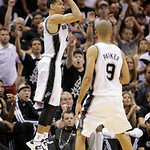 San Antonio Spurs' Danny Green (4) shoots against the Miami Heat as Tony Parker (9) looks on during the second half at Game 5 of the NBA Finals basketball series, Sunday, June 16, 2013, in S …