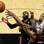 Miami Heat's LeBron James (6), Chris Bosh (1) and San Antonio Spurs' Tim Duncan go after a loose ball during the second half at Game 5 of the NBA Finals basketball series, Sunday, June 16, 2 …