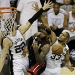 Miami Heat's LeBron James loses the ball as San Antonio Spurs' Tiago Splitter (22), of Brazil, and Boris Diaw (33), of France, defend during the second half at Game 5 of the NBA Finals baske …