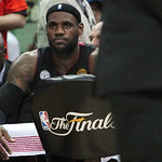 Miami Heat forward LeBron James watches the fourth quarter of Game 5 in the NBA Finals against the San Antonio Spurs in San Antonio on Sunday, June 16, 2013. The Spurs won 114-104. James sco …