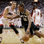 Miami Heat shooting guard Mike Miller (13) looks on as San Antonio Spurs small forward Kawhi Leonard (2) moves the ball during the second half of Game 6 of the NBA Finals basketball game, Tu …