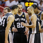 San Antonio Spurs speak on the court during the second half of Game 6 of the NBA Finals basketball game against the Miami Heat, Tuesday, June 18, 2013 in Miami. (AP Photo/Lynne Sladky)