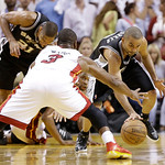 San Antonio Spurs point guard Tony Parker (9) moves the ball against Miami Heat shooting guard Dwyane Wade (3) during overtime of Game 6 of the NBA Finals basketball game, Wednesday, June 19 …