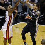 San Antonio Spurs shooting guard Danny Green (4) drives to the basket as Miami Heat point guard Mario Chalmers (15) defends during the second half of Game 6 of the NBA Finals basketball game …