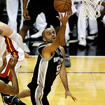 San Antonio Spurs guard Tony Parker (9) drives to the basket during the first half of Game 6 in their NBA Finals basketball series against the Miami Heat, Tuesday, June 18, 2013 in Miami. (A …