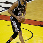 San Antonio Spurs power forward Tim Duncan (21) looks to pass during the first half of Game 6 of the NBA Finals basketball game against the Miami Heat, Tuesday, June 18, 2013 in Miami. (AP P …