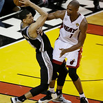 San Antonio Spurs shooting guard Danny Green (4) looks to pass under pressure from Miami Heat center Chris Bosh (1) during the first half of Game 6 of the NBA Finals basketball game, Tuesday …