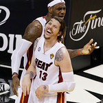 Miami Heat shooting guard Mike Miller (13) and Miami Heat small forward LeBron James (6) laugh at an official's call during the second half of Game 6 of the NBA Finals basketball game agains …