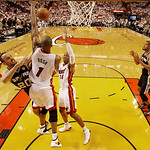 San Antonio Spurs shooting guard Manu Ginobili (20) of Argentina drives to the basket in overtime as Miami Heat center Chris Bosh (1) and Miami Heat shooting guard Ray Allen (34) defend of G …