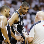 San Antonio Spurs power forward Tim Duncan (21) and San Antonio Spurs point guard Gary Neal (14) listen to official Joe Crawford (17) during the second half of Game 6 of the NBA Finals baske …