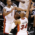 Miami Heat center Chris Bosh (1) and Miami Heat shooting guard Ray Allen (34) celebrate after overtime of Game 6 of the NBA Finals basketball game against the San Antonio Spurs, Wednesday, J …