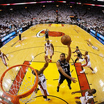 San Antonio Spurs power forward Tim Duncan (21), shoots against the Miami Heat during the second half of Game 6 in the NBA Finals basketball game,  Wednesday, June 19, 2013 in Miami. The Mia …