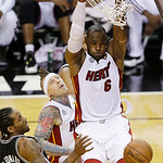 Miami Heat small forward LeBron James (6) dunks the ball against San Antonio Spurs small forward Kawhi Leonard (2) during the second half of Game 6 of the NBA Finals basketball game, Tuesday …