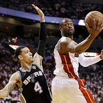 Miami Heat shooting guard Dwyane Wade (3) shoots against San Antonio Spurs shooting guard Danny Green (4) during the second half of Game 6 of the NBA Finals basketball game, Tuesday, June 18 …