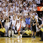 Miami Heat shooting guard Ray Allen (34) reacts to shot that took the game into overtime during the second half of Game 6 of the NBA Finals basketball game against the San Antonio Spurs, Wed …
