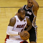 Miami Heat small forward LeBron James (6) drives to the basket as San Antonio Spurs center Boris Diaw (33) of France during the second half of Game 6 of the NBA Finals basketball game, Tuesd …