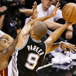 Miami Heat point guard Mario Chalmers (15) defends against San Antonio Spurs point guard Tony Parker (9) during the second half of Game 6 of the NBA Finals basketball game, Tuesday, June 18, …