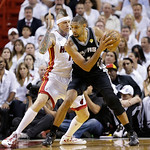 San Antonio Spurs power forward Tim Duncan (21) dribbles as Miami Heat power forward Chris Andersen (11) defends during the first half of Game 6 of the NBA Finals basketball game, Tuesday, J …